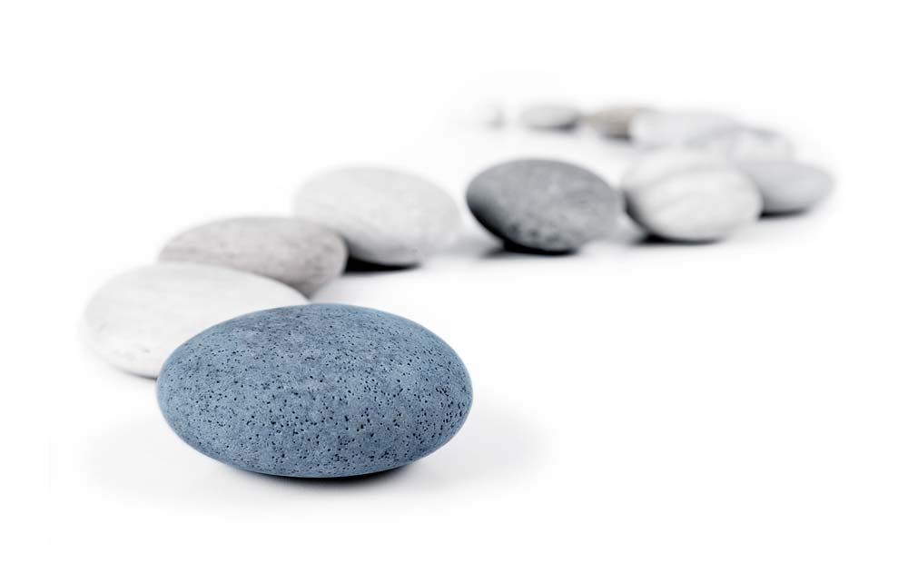 path made out of grey stones with blue stone at the end